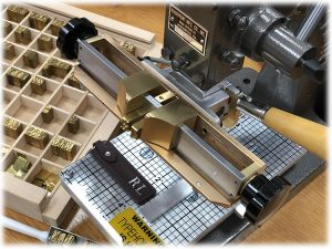 Hot foil printing machine with type